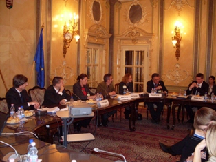 A conference panel sitting in a stately room